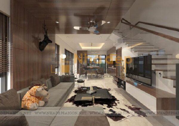 Phòng khách được bố trí với bộ sofa trầm màu kết hợp chiếc bàn được thiết kế khá ấn tượng
