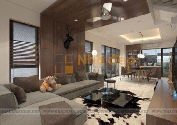 Tầng trệt được thiết kế thông thoáng cùng hệ thống đèn đảm bảo cho phòng khách luôn đầy đủ ánh sáng