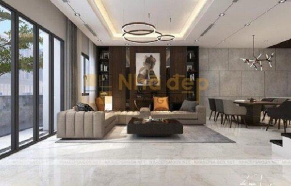 Bộ sofa trầm màu được kết hợp với những chiếu gối sáng màu tạo nên điểm nhấn cho phòng khách