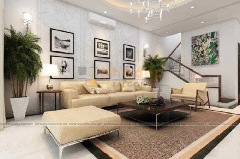 Mẫu phòng khách nhà ống được đặt cạnh cầu thang. Thiết kế bàn ghế đơn giản, sáng màu kết hợp những bức tranh treo tường đã tạo không gian phòng khách sống động hơn dù là chỉ sử dụng những gam màu đơn sắc.
