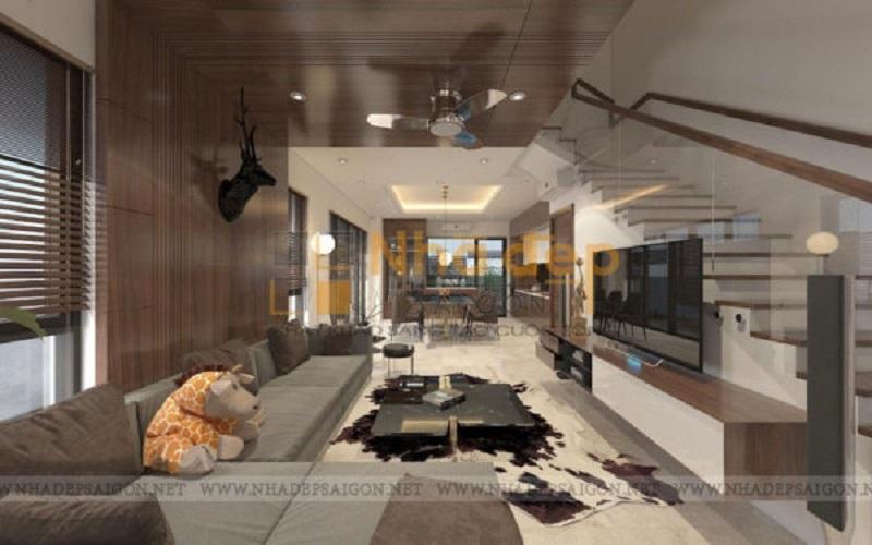 Khi bạn sử dụng góc cầu thang làm điểm nhấn, dù vậy phòng khách vẫn đủ để phô diễn sự sang trọng của mình. Chiếc sofa màu trung tính chạy dọc theo mảng tường đã tạo nên bố cục căn phòng hết sức khoa học